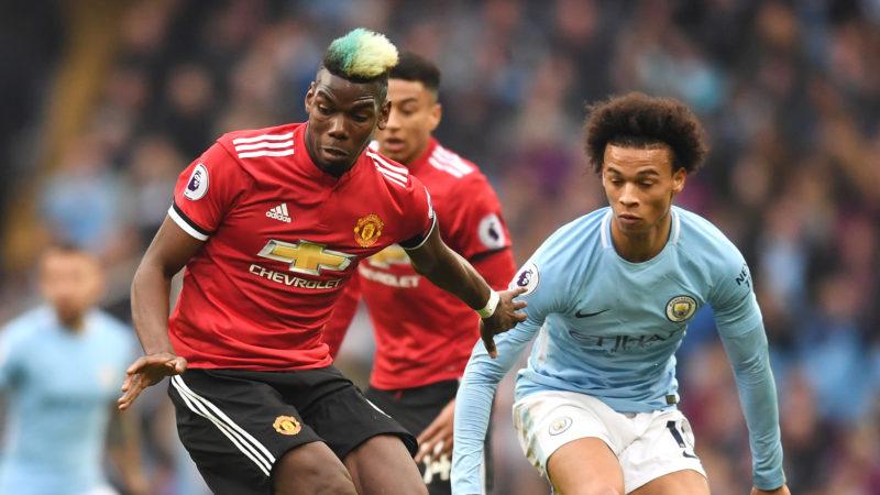 Paul Pogba, de la Manchester United, se dueleaza cu Leroy Sane, de la Manchester City. Premier League, Anglia